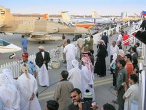 Al Ain Aerobatics Show. AL AIN, UAE - DECEMBER 29, 2004: Diverse unidentified spectators at the Al Ain Aerobatics Show in Al Ain, United Arab Emirates Stock Images