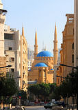 The Al-Amine Mosque in Beirut (Lebanon). Looking over the downtown landmark clock-tower onto the Al-Amine Mosque in Beirut (Lebanon Stock Image