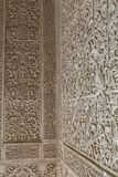Details of arabic geometric mosaic patterns wall inside an historical building in the city of Granada, Spain. royalty free stock photos