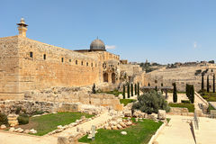 Al-Aqsa dome and old ruins in Jerusalem, Israel. Minaret and dome of Al-Aqsa Mosque surrounded by walls and ancient ruins in Old City of Jerusalem, Israel Stock Images
