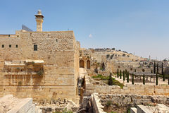 Al-Aqsa minaret and old ruins in Jerusalem, Israel. Minaret of Al-Aqsa Mosque surrounded by walls and ancient ruins in Old City of Jerusalem, Israel Royalty Free Stock Photography