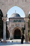 Al-Aqsa Mosque. JERUSALEM - MAY 23: A Muslim woman walks near the Al-Aqsa Mosque on the Haram al-Sharif, also known as the Temple Mount, in the Old City of Stock Image