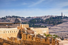 The Al-Aqsa Mosque and the Muslim minaret. The walls of Jerusalem. In the distance you can see the gray dome of the Al-Aqsa Mosque and the Muslim minaret Royalty Free Stock Photography