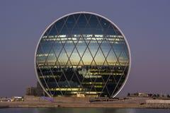 Al Dar förlägger högkvarter byggnadssolnedgång Arkivbild