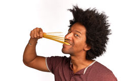 Al dente. Biting in a bunch of spaghetti, concept for al dente cooking royalty free stock photo