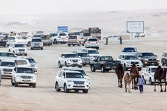 Al Dhafra Camel Festival in Abu Dhabi. MADINAT ZAYED, UAE - DEC 22: Emirati people in their cars at Al Dhafra Camel Festival in Al Gharbia. December 22, 2014 in Royalty Free Stock Image