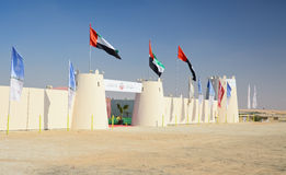 Al Dhafra Camel Festival in Abu Dhabi. ABU DHABI, UNITED ARAB EMIRATES - DEC 27, 2015: Entrance with UAE flags at Al Dhafra Camel Festival in Al Gharbia, Abu Royalty Free Stock Photography