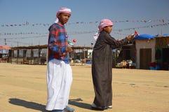 Al Dhafra Camel Festival in Abu Dhabi. ABU DHABI, UNITED ARAB EMIRATES - DEC 27, 2015: Two boys at Al Dhafra Camel Festival in Al Gharbia, Abu Dhabi, UAE Royalty Free Stock Images