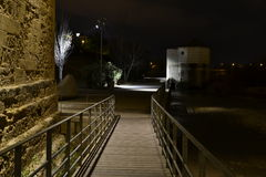 Al final del camino de madera. Crossing the wooden walkway below the Roman bridge in Cordoba, Spain, arrive at the mill San Antonio, well lit, although the Royalty Free Stock Images
