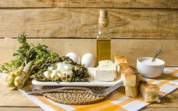 Al forno l'erba commestibile della molla con le uova ed il latte acido Fotografia Stock Libera da Diritti