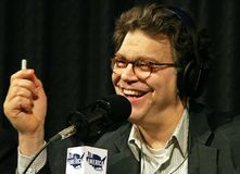 Al Franken. Comic and political humorist, Al Franken, makes an irreverent point during a broadcast of `The Al Franken Show,` on `Air America,` an erstwhile Royalty Free Stock Image