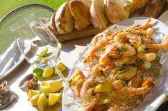 Al fresco dining with fresh shrimp. And crusty bread Stock Images