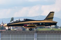 Al Fursan Aerobatic team from the United Arab Emirates Air Force flying Aermacchi MB-339 jet training aircraft. Payerne, Switzerland - September 6, 2014: Al royalty free stock images