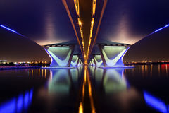 Al Garhoud Bridge in Dubai. The Al Garhoud Bridge in Dubai crosses the Creek and it is illuminated at night stock images