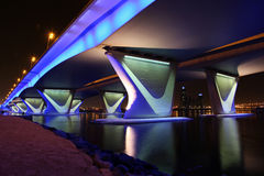 Al Garhoud Bridge in Dubai. The Al Garhoud Bridge in Dubai crosses the Creek and is illuminated at night royalty free stock photos