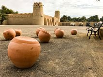 Al Jahili Fort is one of the UAE's most historic buildings. And It was erected in 1891 to defend the city and protect precious palm groves stock image