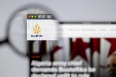 Al Jazeera logo visible  through a magnifying glass. royalty free stock photography