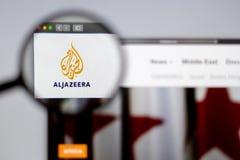 Al Jazeera logo visible  through a magnifying glass. New York, USA - March 26, 2019: Arabian News media Al Jazeera website homepage. Al Jazeera logo visible royalty free stock images