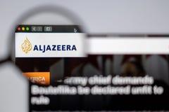 Al Jazeera logo visible  through a magnifying glass. New York, USA - March 26, 2019: Arabian News media Al Jazeera website homepage. Al Jazeera logo visible stock image