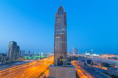 The Al Kazim Towers in Dubai Media City at night Stock Images