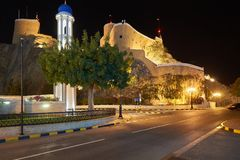 Al Khor Mosque and Al Mirani Fort. At night. Oman. Muscat Stock Image