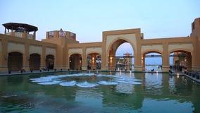 Al Kout Mall in Kuwait at dusk stock footage