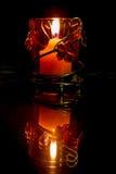 Al lLight di una candela Fotografia Stock