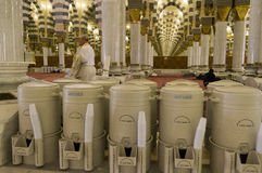 AL MADINAH, KINGDOM OF SAUDI ARABIA-FEB. 17: Rows of drums of zamzam water inside Masjid Nabawi on February 17, 2012 in Al royalty free stock images