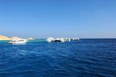 AL-MAHMYA ISLAND, EGYPT - OCTOBER 17, 2013: Sailboats near island Al-Mahmya with tourists. Stock Images