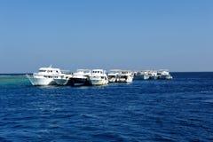 AL-MAHMYA ISLAND, EGYPT - OCTOBER 17, 2013: Sailboats near island Al-Mahmya with tourists. Royalty Free Stock Photo