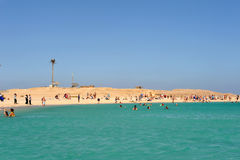 AL-MAHMYA ISLAND, EGYPT - OCTOBER 17, 2013: Unidentified people swimming and sunbathing on the island. Royalty Free Stock Image