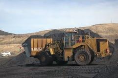 Al mucchio di carbone Immagine Stock