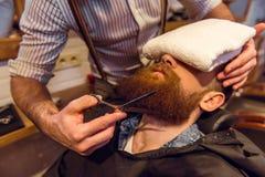 Al negozio di barbiere fotografia stock libera da diritti