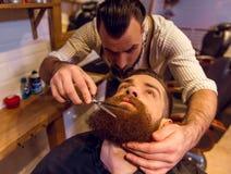 Al negozio di barbiere immagine stock libera da diritti