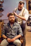 Al negozio di barbiere immagini stock libere da diritti