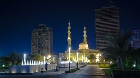 Al Noor Mosque in Sharjah at night timelapse. United Arab Emirates. Al Noor Mosque in Sharjah at night with fountain timelapse hyperlapse. United Arab Emirates royalty free stock photos