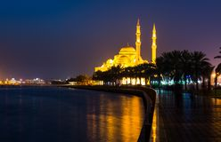 Al Noor mosque in Sharjah reflected in the lake. At night Royalty Free Stock Photo