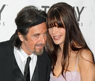 Al Pacino and Lucila Sola. Actor Al Pacino and longtime girlfriend, Argentinian actress Lucila Sola arrive on the red carpet for the 65th Annual Tony Awards at Royalty Free Stock Photos