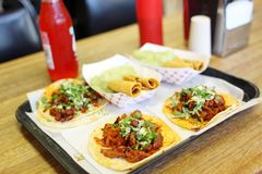 Al pastor soft tacos with taquitos Royalty Free Stock Photo