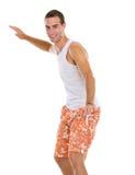 Al practicar surf sonriente del hombre joven de las vacaciones aislado imagen de archivo libre de regalías