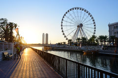Al Qasba canal and Eye of the Emirates wheel in Sharjah royalty free stock photos