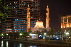 Al Qasba Mosque at night in Sharjah, United Arab Emirates Stock Image