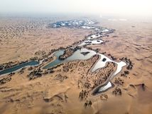 Al Qudra lakes in Dubai desert aerial view. Al Qudra lakes in the Dubai desert aerial view oasis tranquil nature sunrise quiet sand outdoor dry uae landscape stock photography