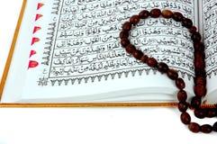 Al Quran and prayer beads Stock Photos