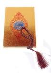 Al Quran and prayer beads Stock Image