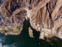 Al Rafisah Dam in Khor Fakkan in the United Arab Emirates. Aerial view uae lake sharjah water reservoir desert mountain sandstone rock above drone picmic spot royalty free stock image
