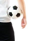 Al revés del hombre de negocios que sostiene el balón de fútbol Imagenes de archivo