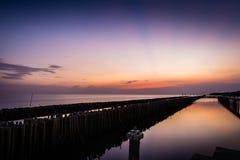 Al tramonto sulla spiaggia Fotografia Stock Libera da Diritti