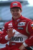 Al Unser Jr Indy Car Driver. Al Unser Jr Indy race car driver waving to the fans in the pit area stock image