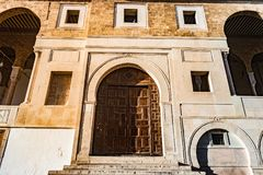 Al-Zaytuna Mosque in Tunis, Tunisia. Main entrance with stairs and wooden door Royalty Free Stock Images